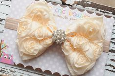 DCB - GORGEOUS Cream rosette bow on a soft elastic headband. Available for newborns, toddler, child, teen or adult. $13.00, via Etsy.