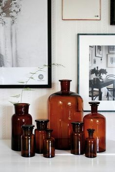 A Swede and a Londoner sharing their interior design ideas and inspirations alongside fashion, travel and lifestyle posts. We hope you enjoy / Amanda & Kai Brown Bottles, Amber Glass Bottles, Vibeke Design, Ranch Decor, Boho Kitchen, Apothecary Jars, Art Deco Design, Second Hand, Home Decor Furniture