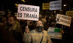 Spanish demonstrators protest against the new Citizen Security Law.
