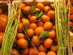 Fresh oranges and wild asparagus at the Atarizanas central market in Malaga, Spain.