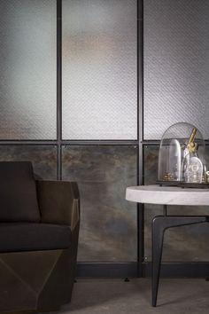 """Wall Divider """"Frankford Panel System"""" by Amuneal: blackened steel patchwork and wire glass"""
