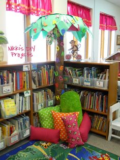 I built this tree in the library out of an umbrella, wrapping paper rolls, and butcher paper. I bought foam letters A-Z for $ 2 (not sure where) and stuck them to the leaves and trunk. I spy the monkey hanging from the tree! The big green pillow is from my mom (thanks, mom!), and I recovered the other pillows. I can take the covers off to wash them very easily, so that is an added bonus.