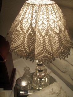 Use a doily over a lamp shade