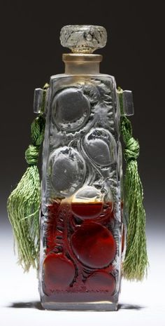 A René Lalique 'Ambre de Siam' perfume bottle, circa 1919. One of two models R. Lalique made for Volnay's 'Ambre De Siam' perfume, this bottle was also made for Maison Lalique as the 'Gros Fruits' perfume bottle, model #501. #Lalique #PerfumeBottle