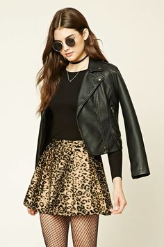 A woven mini skirt featuring a leopard print, pleated design, glitter accents, and a concealed back zipper.