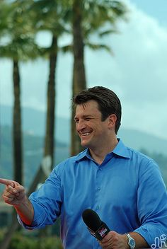 Nathan Fillion- that smile kills me.
