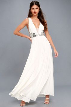 Lulus Exclusive! It's your time to shine in the Neverending Love White Sequin Maxi Dress! Lovely pleated chiffon creates a plunging V-neckline (with mesh insert), and fitted bodice with silver beaded sequin appliques. Empire waist leads into a full maxi skirt. Crisscrossing back straps and hidden zipper/clasp.