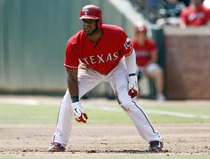 CrowdCam Hot Shot: Texas Rangers shortstop Elvis Andrus takes a lead off first base against the Oakland Athletics during the first inning of a baseball game at Rangers Ballpark in Arlington. Photo by Jim Cowsert