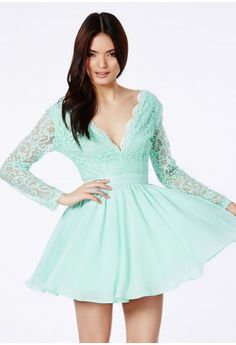 For a lacy luxe SS14 feel, this gorgeously cool mint number is perfect. The beautiful lace, the daring v-neck detail and the powerful puff ball skirt makes this a sophisticated wonder. Simply wear with strappy heels, a clutch bag and a long...