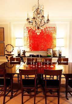 10 Celebrity Dining Rooms You'll Love // Traditional furniture and a crystal chandelier face off against eye-catching contemporary art in the New York apartment of fashion designer Kate Spade and branding exec Andy Spade.