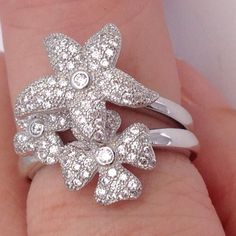 💯% 925 silver clover starfish hinge ring Size 7 Price ⬇️ Gorgeous,💍✨ sparkling, AAA luster, white, cubic zirconia adorned ring, inlaid into shapes of star fish, and 2 flowers, size 7, hinged, so you can wear as one ring ( as pictured in first photo) or swivel over and wear starfish on finger to the right of flower settings, so it's  😱 two rings in one. ( see photo # 2) made of💯% 925 Sterling silver, with white,  💯% 14 k gold overlay, ( so no tarnishing-or need to polish) handmade to…