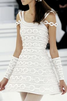 #Chanel Couture Spring 2006#Details If the skirt fit a little tighter I'd swear this was from the 60's or early 70's!