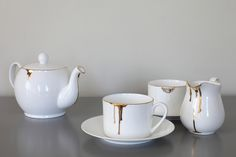 Drip Tease cup and saucer in gold | Reiko Kaneko