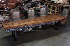 Extreme curly redwood wood slab with organic natural live edge supported by a metal base