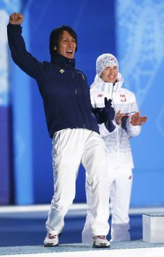 Gold medallist Poland's Stoch and silver medallist Japan's Kasai celebrate during the victory ceremony for the men's ski jumping...