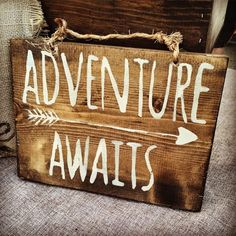 "Adventures are waiting! I stained this pine wood in a dark espresso brown, hand lettered it in ivory paint and sealed it for long wear. It hangs by twine. This sign measures approximately 8"" x 10"". Ev"