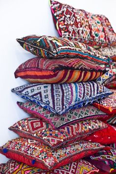 nice bohemian throw pillows - we love the colorful medley of fabrics and textures...