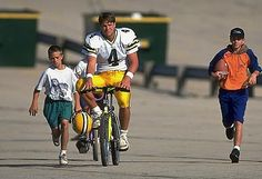 Brett Favre. 1993. During summer training camp, the players always took time out to interact with the kids who had came to see them practice. The players would ride their bikes around the parking lot, and some of those bikes are cemented into the Packers Hall of Fame in Lambeau Field.