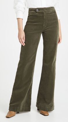 Fabric: Mid-weight, super-stretch corduroy Button closure and zip fly Welt hip and patch back pockets Shell: 98% cotton/2% polyurethane Wash cold Made in the USA Measurements Measurements from size 26 Rise: 11.75in / 30cm Inseam: 33.5in / 85cm Leg opening: 23.5in / 60cm Corduroy Pants, Khaki Pants, Florence Pugh, Wide Leg Pants, Trousers, Legs, Denim, Model, Jeans