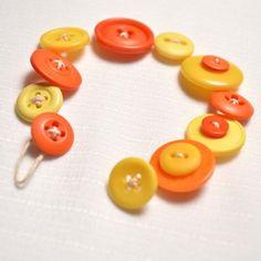 Button Bracelet in Bright Yellow and Orange Strung on Hemp Cord | GracefulArts - Jewelry on ArtFire