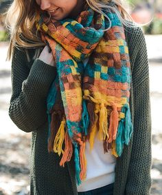 Leto Collection Orange & Blue Patchwork Tassel Scarf | zulily . $11.99 $48.75  .  Product Description:  Woven patchwork and large tassels bring boho charm to this cheery scarf that brings a splash of color to your cold-weather ensembles.      25'' x 82'' .     100% acrylic .     Machine wash .     Imported
