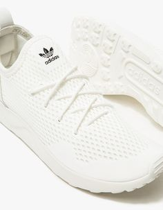 on sale 6d78c e43e8 From Adidas, a runner inspired sneaker in White. Featuring a mesh upper…  Zapatillas