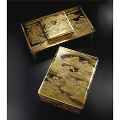 A fine imperial lacquer set of writing implement box and cover (suzuribako), document box and cover (ryoshibako) and writing table (bundai)  c.1886 - Decorated in gold hiramaki-e, takamaki-e, kirigane, kanegai, nashi-ji, kimpun and gold foil with flowering cherry trees within a mountainous landscape and a stream, the interior of the cover decorated in the similar manner with red lacquer accents, with young pines and flowering cherry trees on hills on a nashi-ji ground,