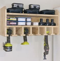 """$110.95 · This cordless tool holder is great for getting your tools, chargers and batteries up off your bench and in a place where they're safe and always where you can find them. Made from 3/4"""" plywood. Dimensions are 27"""" wide x 12"""" tall x 10"""" deep Has slots for 6 cordless tools, top shelf with included power strip and middle shelf for storage. #organization #garagestorage #garage"""