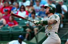 Brett Lawrie hits a grand slam HR during the Oakland A's 8-2 win over the Texas Rangers on June 24, 2015.