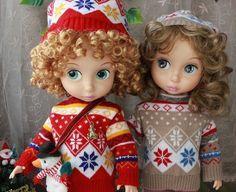 So cute.  Re-wigged Disney Animator dolls.