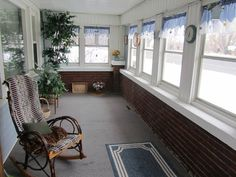 old house enclosed front porches | the wood is beautiful, there are hardwoods under those pink carpets ...