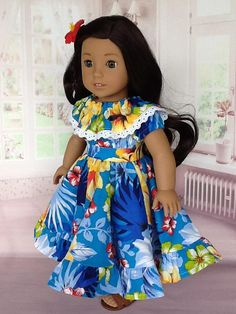 For this dress ASewSewShop used a bright blue Hawaiian print with colorful flowers. The bodice is peasant style with a ruffled neckline and has velcro closing. I added a row of lace on the ruffle.It has elastic casing in the neck and sleeves. It is gathered to a small waistband. The skirt is a