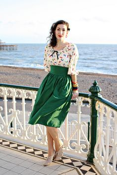 The lovely Fleur in a green gathered skirt and fun print peasant blouse.