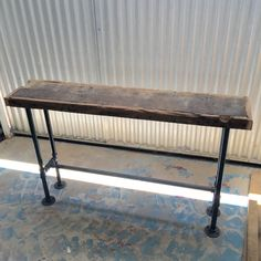 Handcrafted console table. Steel Pipe with Iron Fittings and Reclaimed Wood. 48x12x30 Custom sizes available in your dimensions. Finish is also customizable with stain colors, paint, distressed, rustic, texture, sheen, etc. Farmhouse-style wood table base also available. --Heirloom quality reclaimed wood and steel furniture. Industrial, Rustic, Farmhouse. --Handcrafted of antique reclaimed pine, hemlock, or oak. Variations in the wood are to be expected, further enhancing the uniqueness o...