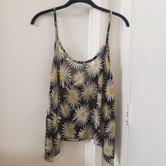 Brandy Melville Sunflower Top This top has never been worn before and is in perfect condition. It is a soft chiffon-type material. It scoops a bit lower in the back (as pictured). ☺️ Brandy Melville Tops
