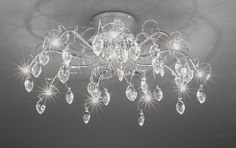 FL2234/10 Chantilly 10 light semi-flush, chrome and crystal. Beautiful chrome finish flush fitting with drapes of fine metalwork and crystal drops. Supplied with low voltage halogen bulbs. Not suitable for dimming.  10 x 20w G4 Lamps included Height- 30cm Diameter- 66cm BRAND: Franklite  REFERENCE: FL2234/10 AVAILABILITY: 3-4 Working Days