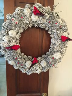 The winter wreath that I made for my Dad's door at his place. I could not find the actual pine cones I wanted from the pin but this was a premade pine cone wreath from Hobby Lobby that I spray painted white added the cardinals, berries, and ice branches. As usual last minute! It has been through a lot and now I have to figure out what wreath I will do for Easter/spring.