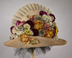 1920's straw cloche hat adorned with silk and velvet flowers