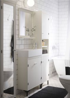good small bath vanity.  A white bathroom with narrow wash-basin cabinet, high cabinet and mirror cabinet