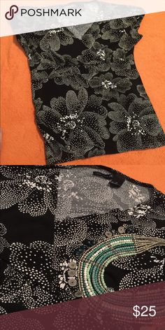 Super cute top Black top with white dot design and flowers. Crossover front. Excellent condition.  Poly blend new directions Tops