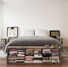 Book storage at the foot of the bed