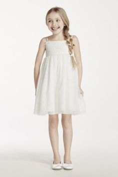 This short gown with spaghetti straps is perfect for your little princess!  Spaghetti strap short gown with lace bodice and tulle skirt.  Bow detail at straps.  Sizes 2T-14. Available in Soft White online and at select stores.  Fully Lined. Imported. Dry Clean Only.