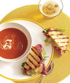 Tomato Soup With Roast Beef, Cheddar, and Horseradish Panini|Tomato soup served with grilled cheese is the ultimate comfort food. Upgrade the sandwich by adding roast beef, arugula, and horseradish cream.