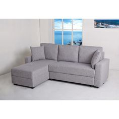 Go for a simple yet elegant modern look in your living room or den with this stylish convertible sectional sofa bed. This handsome fabric sofa with contemporary detailed stitching conveniently doubles as Modular Sectional Sofa, Modern Sectional, Sleeper Sectional, Richmond Apartment, L Shaped Sofa Designs, Fold Out Beds, Beach Living Room, Sofa Bed With Storage, Best Sectionals