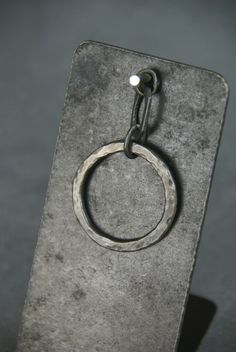 Simple Circle Pendant: Blackened sterling silver circle has a hammered texture, and is also available without a patina.