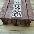 """Pallet Coffee Table :: Hometalk, incorporated 2 pallets and also the """"metal detailing from the back of a rotted out garden bench"""", on casters."""