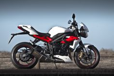 Street Triple R in Crystal White, with accessory flyscreen, belly pan, Arrow slip-on, crash protectors, passenger seat cowl.