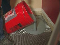 concrete floor DIY. Pour texture pave on floor one bucket at a time