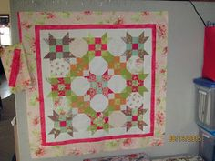 """Small version of Cindy Lou Who from another BiTE OF SCHNiBBLES 23 quilts from 5"""" or 10"""" squares by Carrie Nelson using Honey Sweet by Moda charms packs with a Bella solid charm pack. 35 x 35 inches."""