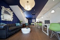Bold choice of colour, statement lighting and stunning items of furniture make for a very enticing estate agent.
